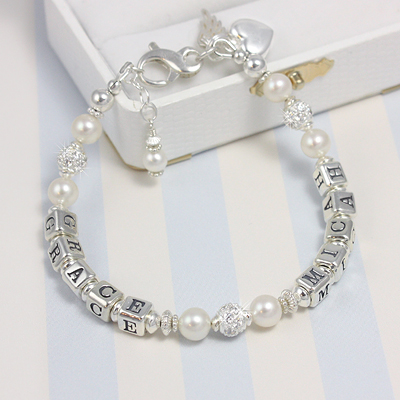 Lovely personalized bracelets with two names on one strand. Our personalized bracelets have cultured pearls and sparkling cz beads.