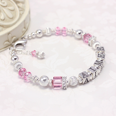 Gorgeous name bracelets in polished sterling and pink Swarovski crystals. Cubic zirconia adds sparkle to our mommy bracelets.