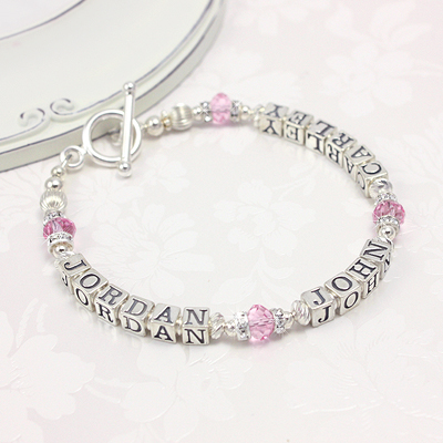 Personalized bracelets in sterling, pink crystals, and sparkling cz. Add two or three names.