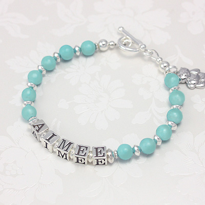 Name bracelets in soft blue genuine turquoise. The blue turquoise highlighted with polished sterling makes an elegant mothers bracelet.