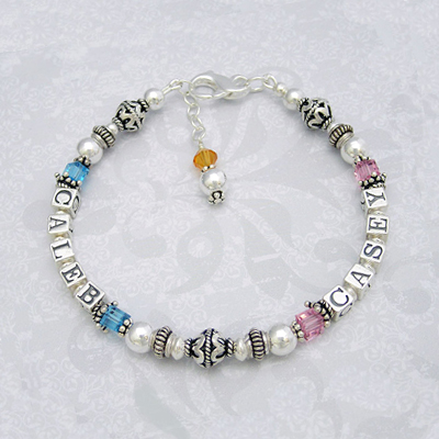 Personalized bracelets for mothers with two or three names and birthstones on one strand.