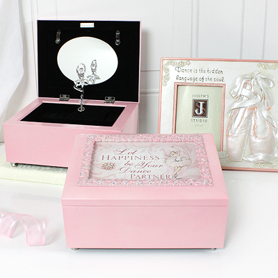 Musical keepsake box for girls in pink. Keepsake box has hinged photo lid, fully lined interior, and plays 'Dance of the Sugar Plum Fairy'.