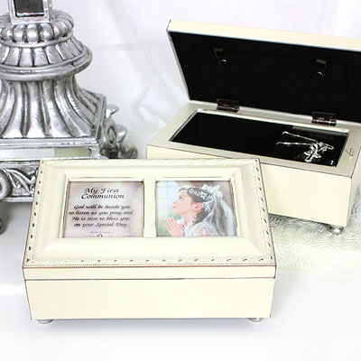 Musical keepsake box for girls in cream with gold trim. Keepsake box has photo lid, fully lined interior, and plays Ave Maria.