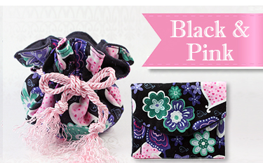 Black and pink puff and pouch for storing children and teen jewelry.
