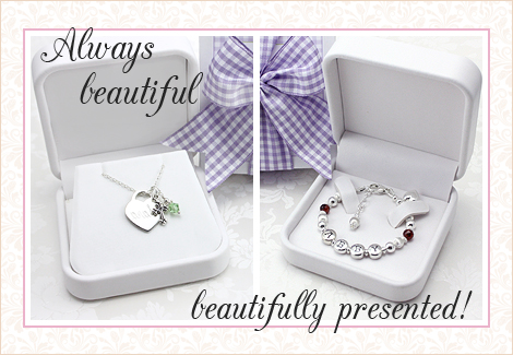 White jewelry box packaging for children's jewelry. Children's necklace packaging and baby bracelet packaging.