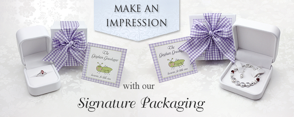The Gingham Grasshopper's Signature packaging for baby and children's jewelry.