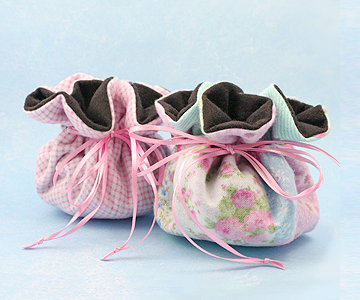 Two small jewelry puff designs perfect for storing baby and children's jewelry to keep items from damage.