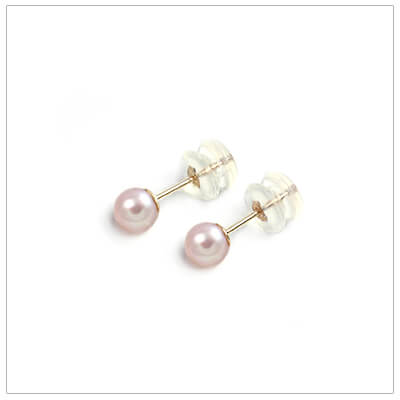 Soft pink pearl earrings for children in 14kt gold. These pearl earrings have safety backs.