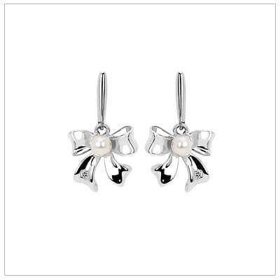 Sterling silver bow earrings for children set with white pearls and melee diamonds.