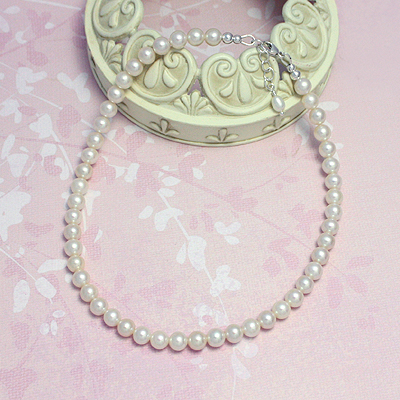 White cultured pearl necklace for girls with sterling silver or 14kt gold clasp. Baby & childrens jewelry.