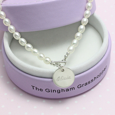 Cultured pearl necklace for girls with front toggle clasp and engraved disc. Beautiful personalized pearl necklace for toddlers and children.