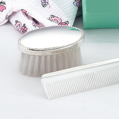 Sterling silver brush and comb set with a beaded edge for baby boys. Our baby gift can be personalized with custom engraving.