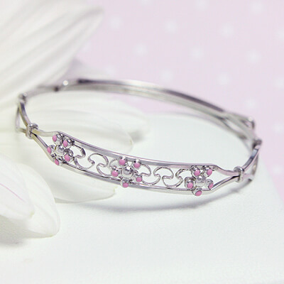 Sterling bangle bracelets with a row of pink flowers, the adjustable sizing will fit babies, toddlers, and children.