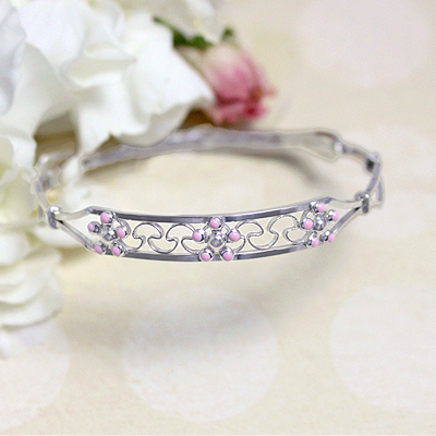 3 pink flowers adorn these sterling bangle bracelets. Adjustable sizing fits baby, toddler, and child.