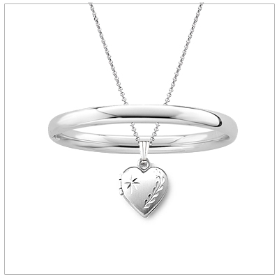 Polished silver bangle bracelet and diamond-cut locket jewelry set for children. Bangle 5.25 inches.