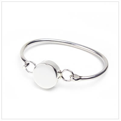 Silver bangle bracelet for babies with round engrave able front.