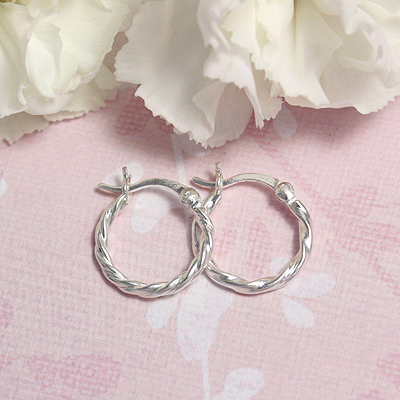 Twist hoop earrings in sterling silver for children and teens.