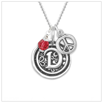 Initial necklace for girls in sterling silver with a wax seal design. The necklace includes a sterling chain.
