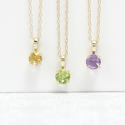 14kt gold April birthstone necklace with 4mm genuine white zircon. 3 chain lengths.