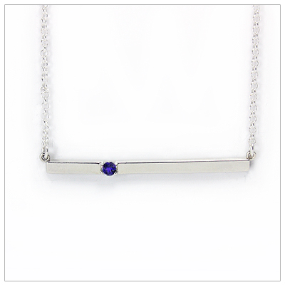 Chic sterling silver bar September birthstone necklace; sleek styling and genuine faceted sapphire.