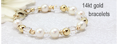 Gold baby bracelet with white cultured pearls and Swarovski cube crystals. Clasp and sizing options for baby, toddler, or child bracelets.