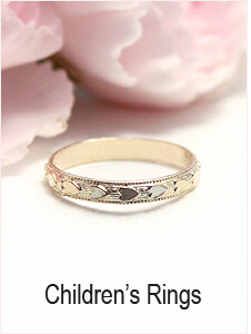 Baby and child's gold ring with a heart border.