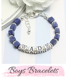 Boys bracelet in blue cube sodalite with sterling letter blocks.