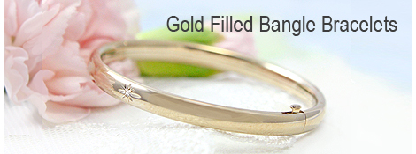 Girls gold filled bangle bracelet with a genuine diamond.