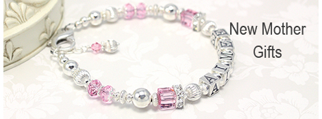 Sterling silver mothers bracelet with pink cube crystals and cz caps.