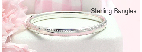 Sterling silver bangle bracelets for babies and children with a beaded border and safety closure.