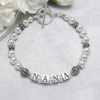 Sterling silver grandmother bracelet with elegant designer beads and name.