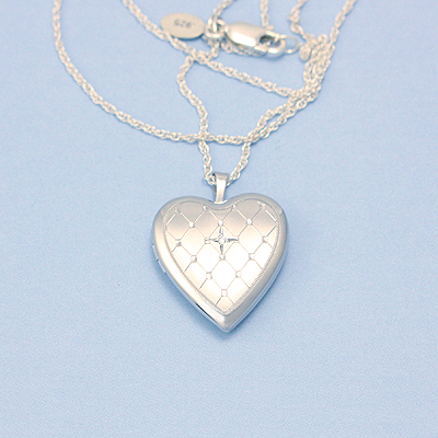 Beautiful heart locket in sterling silver engraved with a quilted pattern and set with a diamond, chain included