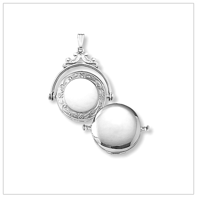 Quality silver locket in the spinner style that rotates, beautiful embossed design on front.