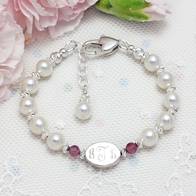 Cultured pearl bracelet has genuine birthstones, diamond cut sterling, and personalized engraving.