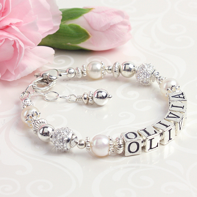 Personalized name bracelet for baby and child with white pearls and sparkling cz beads.