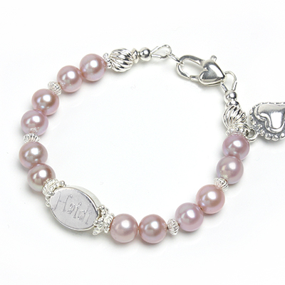 Personalized baby bracelet with custom engraving in white or mauve cultured pearls.