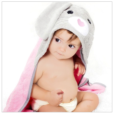 Baby in hooded bunny towel made of 100% organic cotton terry. Our hooded towel available in different designs.