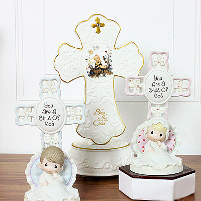 Musical porcelain Cross by MJ Hummel plays 'Jesus Loves Me'; perfect gift for baby baptisms and baby dedications.