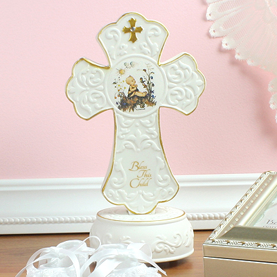Beautiful Baptism gift or baby dedication gift our porcelain Cross by MJ Hummel winds up and plays 'Jesus Loves Me'.