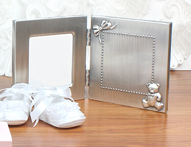 Precious teddy bear and ribbon picture frame that can be custom engraved, a great baby shower gift.