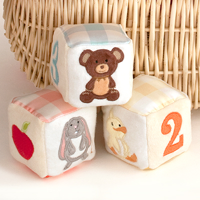 Soft block baby toys made in 100% organic cotton and natural silk. Each block has its own sound: bell, rattle, or squeak. Precious baby gift.