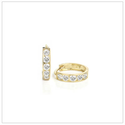 Small cz huggie earrings for baby, toddler, and child set in 14kt yellow gold.