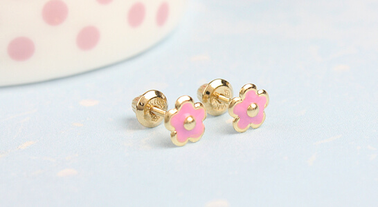 14kt gold pink flower earrings for babies and infants. The gold earrings have screw backs.