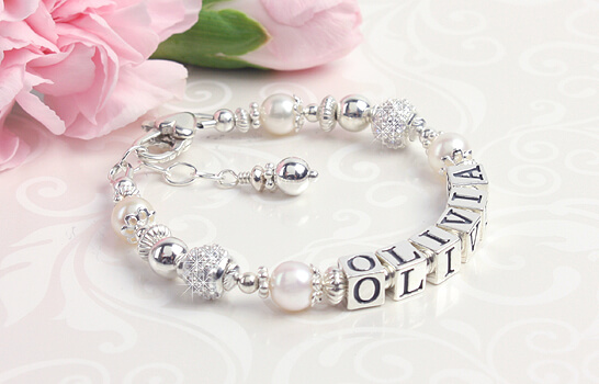 Pearl and birthstone name bracelet for babies and children.