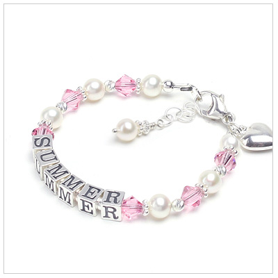 Baby name bracelet in cultured pearls and pink crystal. Personalized name bracelet.