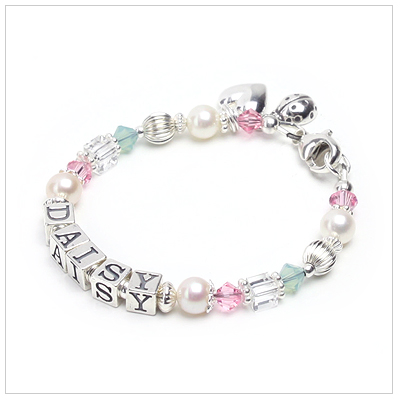 Baby and children's bracelet in cultured pearls and soft colored crystals.