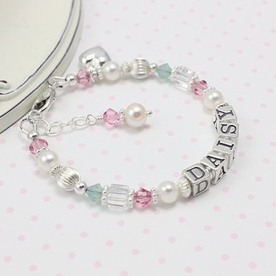 Name bracelets for babies and children in pastel crystals and cultured pearls.
