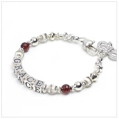 Baby and childrens bracelets with genuine birthstone and personalized name.