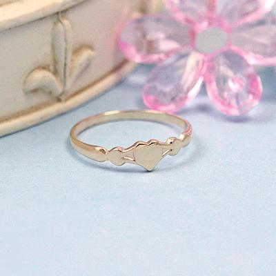 10kt gold baby ring with three tiny hearts.