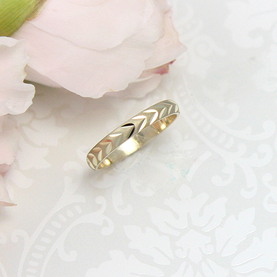 Gorgeous gold baby ring with diamond cut design on the band.